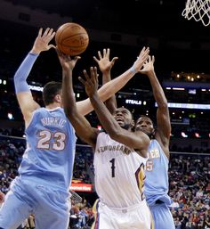 Description of . New Orleans Pelicans guard Tyreke Evans (1) drives to the basket in front of Denver Nuggets center Jusuf Nurkic (23) and forward Kenneth Faried during the first half of an NBA basketball game in New Orleans, Wednesday, Jan. 28, 2015. (AP Photo/Gerald Herbert)