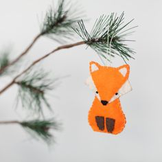 Foxes are mysterious and beautiful animals with striking orange coats that compliment well with their woodland surroundings in the forest.  Each of these little forest creatures is handmade with care from felt, hand stitching and light padding. Each fox is 3.5 inches (9cm) long and 2 inches (5cm) wide. This adorable fox would look lovely as an added touch to a nursery, part of the decoration for a home, a finishing touch on a special gift or as a new addition to your holiday tree just to…