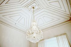 Beautiful ceiling with molding detail, a easy way to add some glam to a room.