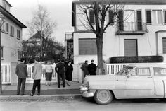 Elvis Presley fans congregate at the house in which Elvis and his family lived, shortly after he left the house for the last time, Bad Nauheim, Germany, March 1960.