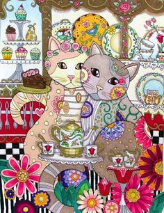 gatti bevono il tè in pasticceria