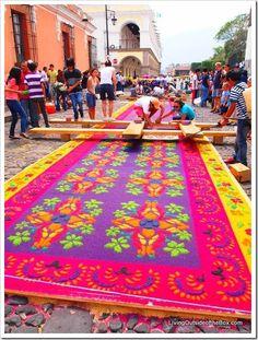 Building the beautiful sawdust carpets for Semana Santa (Holy Week) in Antigua, Guatemala