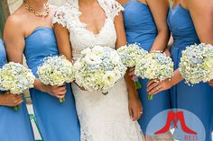 Cornflower blue gowns with delicate hydrangea bouquets.  Gorgeous!