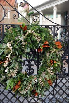 Gorgeous natural wreath on wrought iron gate for a lowcountry Christmas, Charleston, SC   homeiswheretheboatis.net