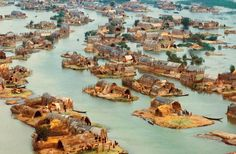 Marsh Arab Village -  Iraq's 'Garden of Eden'; unique wetlands in southern Iraq where a people known as the Ma'dan, or 'Arabs of the marsh', lived in a Mesopotamian Venice, characterised by beautifully elaborate floating houses made entirely of reeds harvested from the open water.