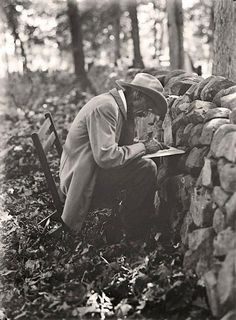 Photograph of an Old Soldier. The picture was taken at the Stone Wall at Gettysburg in 1913. Picture shows the old soldier writing his memories of the Battle of Gettysburg, at the Gettysburg Reunion.