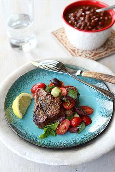 Greek grilled lamb chops with tomato, cucumber, and kalamata olive salad