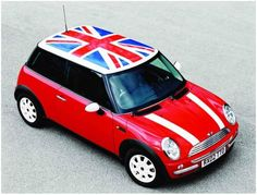 New generation Mini Cooper Red paint with British flag on roof and white bonnet stripes on hood