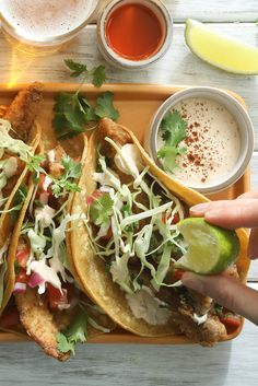 NYT Cooking: Fish tacos, that great meal of the Baja Peninsula, and a taste of summer. They are simple to make, no more complicated in fact than a hamburger or a mess of pancakes, and they are considerably more flavorful. Fried in strips and served onboard warm corn tortillas with a simple salsa, a pinch of fresh cabbage, plenty of lime and a cream sauce you might want to p...