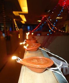 Decor Tip: Combine an array of electrically lit metal diyas in a specific pattern