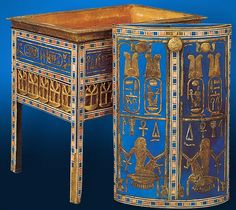 Yuya & Tuyu's Jewelry Coffer of wood decorated with gold & blue faience tiles. The sides , decorated at the bottom with gilded ankh.  The names of Tiye & Amenhotep III, the daughter and son-in-law of Yuya and Tuyu, appear on the sides. At right: the dual cartouches of Nebmaatre-Amenhotep III also appear on the lid of the box