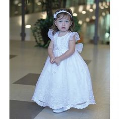 """$77  A darling baptism dress for your baby, toddler or little girl by Angels Garment. Adorable embroidered organza dress with flutter sleeves. Sleeveless cape embroidered with 3 images of """"Our Lady of Guadalupe"""" -two on front and one on back. Made in USA."""