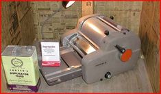 Mimeograph Machine.  Remember the smell of the ditto machine ink?  It smelled soooooo good.  A bright purple-ish blue.  When it first came off the machine, the paper was very cold.