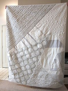 Grey and white quilt.