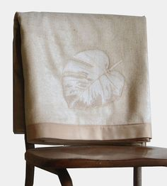 Gold Leaf Silk & Wool Throw Blanket by Local Produce Design // Take the chill off brisk spring and summer nights with this luxe and lightweight throw blanket. The top side is a gorgeous weave of silk and wool, flecked with cream and gold thread, and bedecked with intricately embroidered leaves. The blanket reverses to a soft golden tan wool that perfectly complements the botanical-adorned front.
