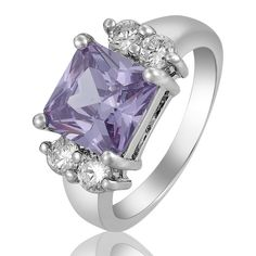 'PRINCESS CUT TANZANITE 18K WGP RING' is going up for auction at  4pm Mon, Apr 29 with a starting bid of $8.