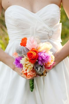 Paper roses via Style Me Pretty designed by the bride herself!