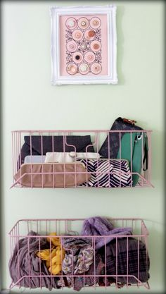 baskets on the wall. would be great for a closet for my purses, scarves.
