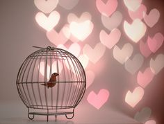 Little bird and shimmery pink hearts