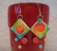Made with polymer clay and alcohol inks. Earrings Supernova by Sarahlerougail, via Flickr
