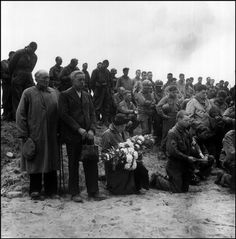 COLEVILLE-SUR-MER, CALVADOS, France—A Roman Catholic chaplain offers a prayer on the beach in memory of those soldiers killed during the D-Day landings, June 6, 1944.