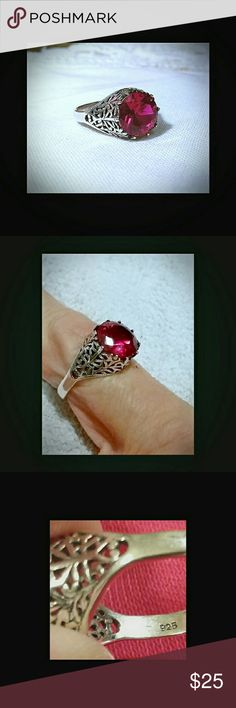 Pretty Ruby &Sterling Silver Ring Beautiful ruby ring , not sure how old it is. I bought it at a thrift store in SLC. Its stamped on the inside of the band. 925.  Its an older setting and handmade, could be antique /vintage. Still its beautiful. Size 7. No trades. Offers welcome Jewelry Rings