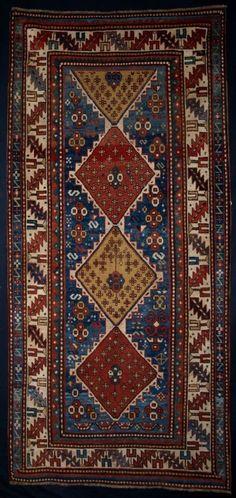 ANTIQUE CAUCASIAN KAZAK LONG RUG, GREAT COLOUR, 19TH CENTURY Size: 8ft 8in x 4ft 1in (265 x 125cm).