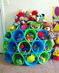 Plastic buckets tied together to create toy storage.... Awesome!!!
