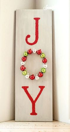 How to make this DIY wooden joy sign for your front door or your home. With this simple kit, you can create your own DIY wooden joy sign to decorate your front door or home. Christmas Decorations For Kids, Christmas Projects, Holiday Crafts, Christmas Ornaments, Christmas Ideas, Holiday Ideas, Wooden Christmas Crafts, Christmas Cactus, Holiday Signs
