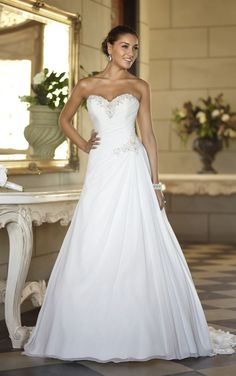 Simple elegant wedding dresses with figure flattering ruched bodice and sweetheart neckline. Exclusive designer simple elegant wedding dresses by Stella York.