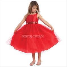 Red Flower Girl Dress with Rhinestone And Tulle Skirt: This gorgeous red rhinestone flower girl dress features a taffeta bodice and tulle skirt with additional netting underneath for a full volume ballerina skirt look. The waistline is embellished with elegant rhinestone jewels, delicate beading, and sequin. Your little princess will be the belle of the day in this exquisite merry red flower girl dress.