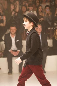 Comedy moments with Charlie Chaplin moustaches on the boys at CIFF Kids fall :winter 2013 preview fashion show.