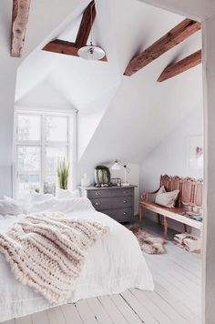 large knit throw and wood beams