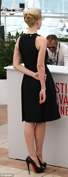 Embracing the sixties: The British star cut an elegant figure in the cinched in dress, which accentuated her pale skin and blonde hair