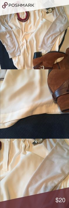 Cream & Grey Sheer Long Sleeve Blouse Cream & Grey Sheer Long Sleeve Blouse from Loft.  Body is Cream and sleeves light Grey  Woven: 100% Polyester. Knit: 77% Polyester, 19% Rayon, 4% Spandex.  No stains, rips or holes.  Massive closet clean out! Love the item but not the price....make an offer! All reasonable offers will be considered.  Any defects will be called out and pictured.  All items are cross-listed.  Thank you for looking and let me know if you have any questions.  Sue LOFT Tops…