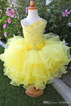 Give your little girl the cute asymmetric neckline yellow organza toddler flower girl dresses for pageant wedding party beaded tiers gowns in flodo as a good gift and have her shine like a bright star with girls purple dress,kids gownsand latest gowns. Toddler Pageant Dresses, Glitz Pageant Dresses, Pagent Dresses, Little Girl Pageant Dresses, Pageant Wear, Girls Pageant Dresses, Flower Girl Dresses, Prom Gowns, Beauty Pageant