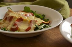 Lobster ravioli, arugula, perfect garlic cream sauce by laura pants, via Flickr