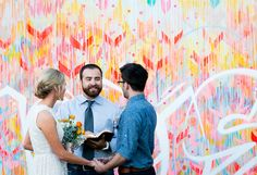 love this colorful ceremony backdrop | Free-Spirited Graffiti Artist Wedding