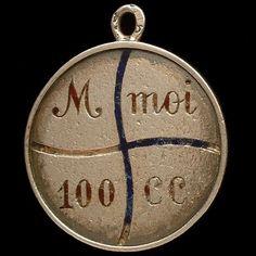 "Old French enamel charm reads, ""M (aime) _ MOI _ 100 (sans) _ CC (cesser) : 'AIME MOI SANS CESSER"" which translates to, ""Don't stop loving me."""