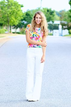 Flared leg pants with floral blouse. 70s inspired outfit