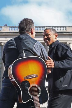 Bruce Springsteen Photos - Rocker Bruce Springsteen (L) welcomes U.S. President Barack Obama to the stage during a rally on the last day of campaigning in the general election November 5, 2012 in Madison, Wisconsin. Obama and his opponent, Republican presidential nominee and former Massachusetts Gov. Mitt Romney are stumping from one 'swing state' to the next in a last-minute rush to persuade undecided voters. - Obama Campaigns In Midwest Swing States One Day Before Election Day