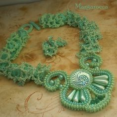 Beadwoven necklace made of wonderful Czech glass button, Czech seed beads, pressed beads and imitation pearls. inspired by Nordic goddess of sea, by glaciers and deadly cold northern seas...