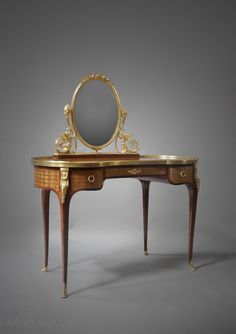 *A Fine Transitional Style Gilt-Bronze Mounted and Parquetry Inlaid Dressing Table.  French, circa 1870.