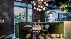 Interiors: Claude Cartier, Black Forest Restaurant, France - tufted velvet banquette
