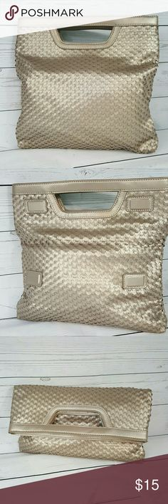 Chico's purse Chico's pewter tone convertible purse. Magnetic closure for foldover clutch. Top zipper for open style. 2 slip pockets and 1 zip pocket in interior. Like new condition. Chico's  Bags Totes