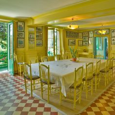 Monet's dining room at Giverny.  Another example of my double-wide table idea.  Plus, love the yellow on yellow!