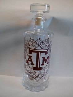 Texas A&M Aggies Hand Painted Carafe / Decanter / Bottle with Lid would be a great gift to your Aggie couple on their wedding day!  Follow thehowdyweddingguide on Instagran for more Aggie wedding shares!