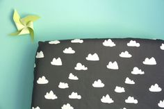 fitted crib sheet in clouds on charcoal