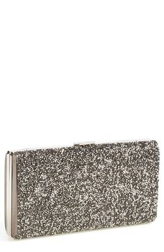 Love this crystal clutch for holiday style. Punch up a dress you already own with metallic accessories.