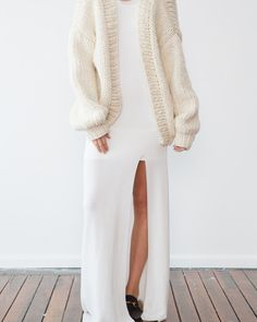 This much-loved piece is a popular and timeless knit created with 100% wool. The Cardigan's super oversized design makes it the perfect pull on for warmth and style. One Size only. Please keep in mind that 'oversized' is key with the cardigan. Hand knitted with 100% pure, soft wool. Colors pictured: Cream and charcoal. ONE …